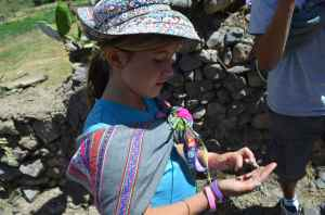 Lucia with prickly-pear fungus called cochinilla- a valuable commodity sold for dyes, lipstick pigment.