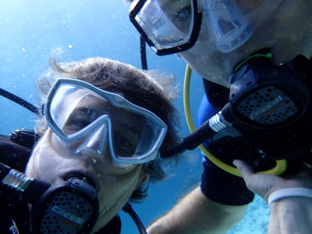 Parent selfie underwater