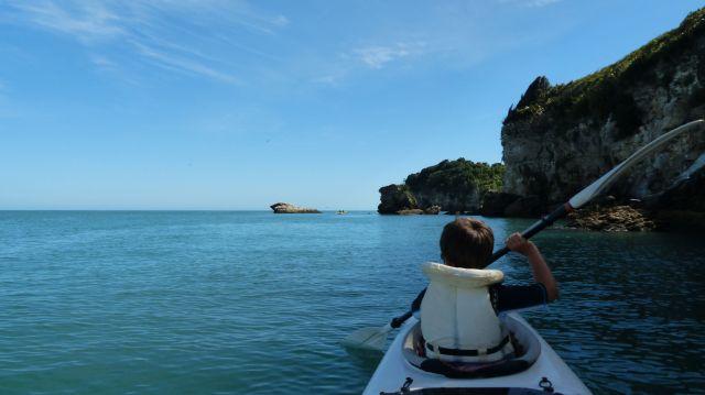 Mac kayaking on by Abel Tasman